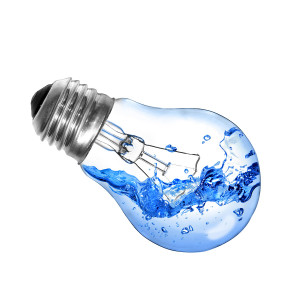 Energy concept. Light bulb with water and splash isolated on whi